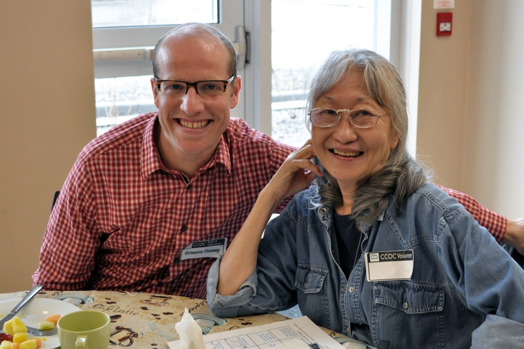 A CCOC staff member and volunteer at a volunteer recognition event